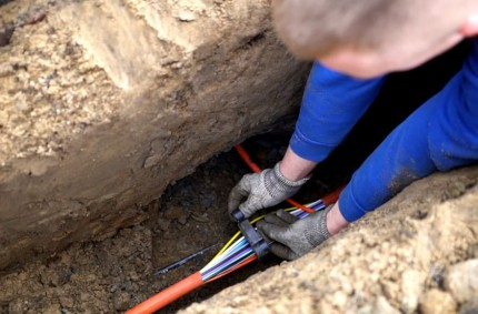 broadband cables are laid in a trench