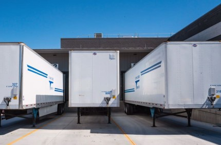 three truck trailers standing at one unloading station